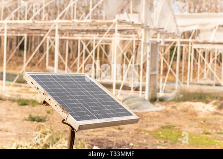 Small size solar cells panels in a garden. - Stock Photo