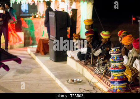 Rajasthani musicians sitting and playing traditional instruments - Stock Photo