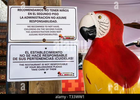 Cartagena Colombia El Laguito sign El Muelle Restaurante Bar restaurant Lagito Beach Spanish English language languages warnings children belongings - Stock Photo