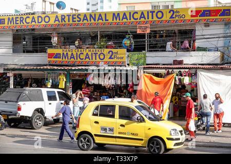 Cartagena Colombia Bocagrande artisanal flea market handicrafts front entrance yellow taxi taxis cab cabs shopping - Stock Photo