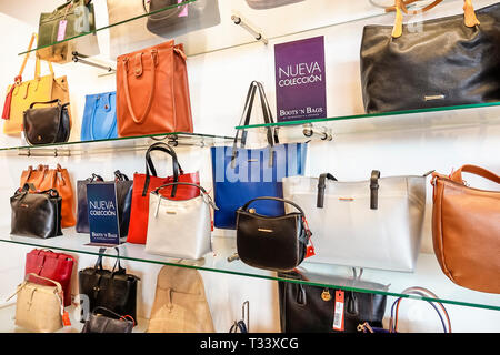 Cartagena Colombia Bocagrande Centro Comercial Nao plaza indoor mall Boots 'N Bags store display sale women's handbags leather goods shopping - Stock Photo