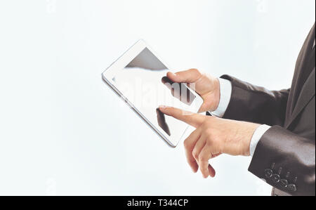 close up.businessman using digital tablet.isolated on white - Stock Photo