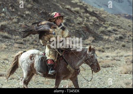 bayan Ulgii, Mongolia, 4th October 2015: kazakh eagle hunter in alandscape of western Mongolia - Stock Photo
