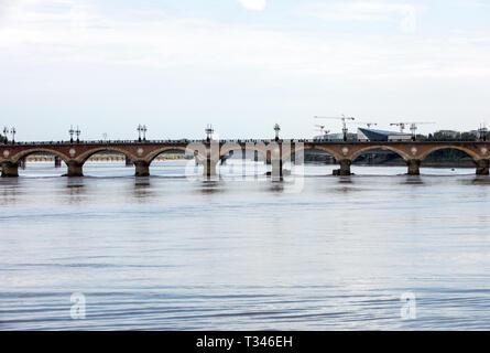 The Pont de Pierre bridge crossing the river Garonne, Bordeaux, France - Stock Photo
