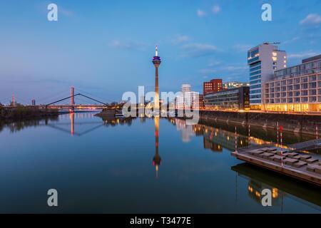 Skyline of Düsseldorf Germany at Sunset - Stock Photo