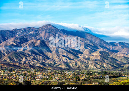 A view of a small city in Lake Elsinore framed against a rugged mountainside. - Stock Photo