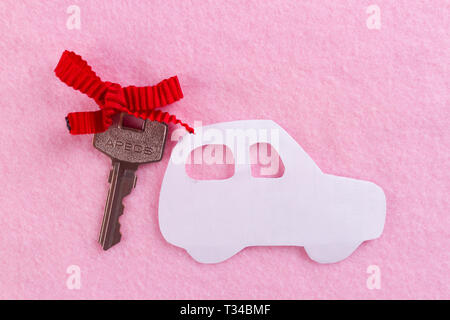 car as a gift on pink background - Stock Photo