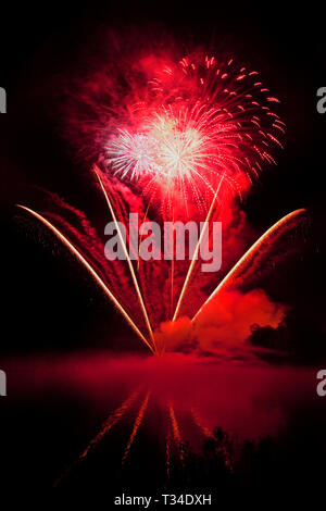 Fireworks by the lake at Sherborne Castle, Dorset UK. - Stock Photo