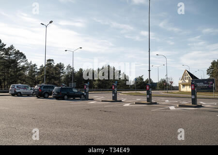 JURMALA, LATVIA - APRIL 2, 2019: People are paying 2 EUR to enter the city after leaving Riga - Stock Photo
