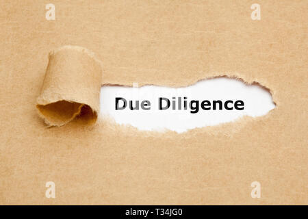 Text Due Diligence appearing behind torn paper. Concept representing the research done before entering into an agreement or contract as a part of the  - Stock Photo