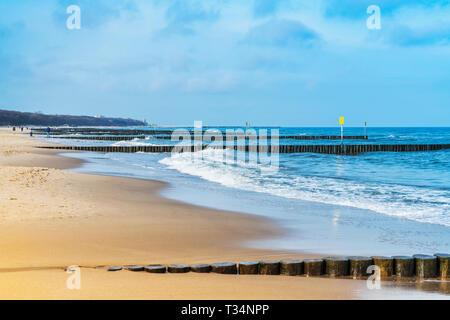 Sandy Beach with groynes on the Baltic Sea, Kolobrzeg, West Pomeranian, Poland, Europe - Stock Photo