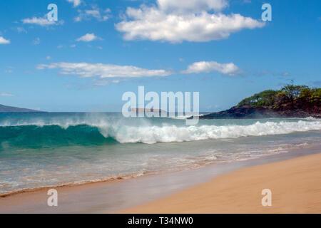 Waves crashing on tropical beach, Maui, Hawaii, United States - Stock Photo