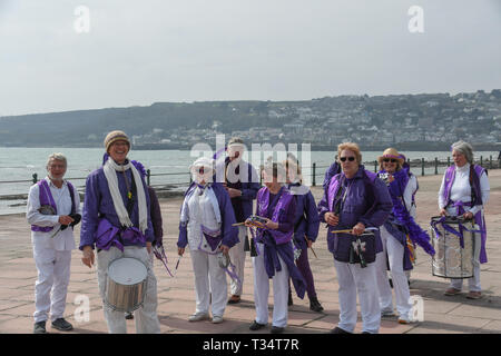 Penzance, Cornwall, UK. 6th Apr, 2019. UK Weather. It was a warm sunny afternoon at Penzance. 'Penzamba' brought a touch of the tropical to Cornwall as they practiced their samba music on the seafront at lunchtime. Credit: Simon Maycock/Alamy Live News - Stock Photo