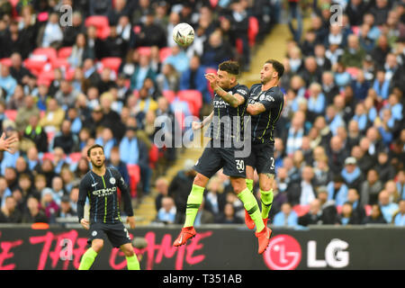 London, UK. 6th Apr, 2019. Manchester City defender Nicolas Otamendi and Kyle Walker head the same ball during the FA Cup Semi Final between Brighton and Hove Albion and Manchester City at Wembley Stadium, London on Saturday 6th April 2019. (Credit: Jon Bromley | MI News) Editorial use only, license required for commercial use. No use in betting, games or a single club/league/player publications. Photograph may only be used for newspaper and/or magazine editorial purposes. Credit: MI News & Sport /Alamy Live News