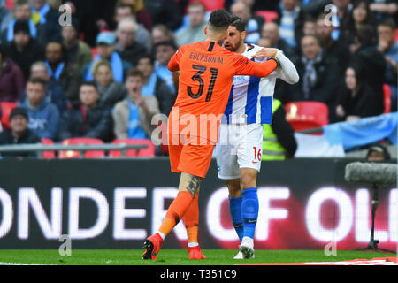 London, UK. 6th Apr, 2019. Manchester City goalkeeper Ederson Moraes holds Brighton forward Alireza Jahanbakhsh back during the FA Cup Semi Final between Brighton and Hove Albion and Manchester City at Wembley Stadium, London on Saturday 6th April 2019. (Credit: Jon Bromley | MI News) Editorial use only, license required for commercial use. No use in betting, games or a single club/league/player publications. Photograph may only be used for newspaper and/or magazine editorial purposes. Credit: MI News & Sport /Alamy Live News