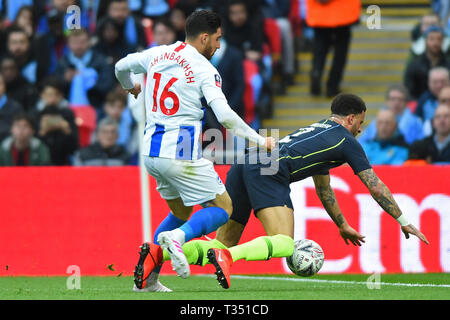 London, UK. 6th Apr, 2019. the push by Brighton forward Alireza Jahanbakhsh that leads to two yellow cards during the FA Cup Semi Final between Brighton and Hove Albion and Manchester City at Wembley Stadium, London on Saturday 6th April 2019. (Credit: Jon Bromley | MI News) Editorial use only, license required for commercial use. No use in betting, games or a single club/league/player publications. Photograph may only be used for newspaper and/or magazine editorial purposes. Credit: MI News & Sport /Alamy Live News