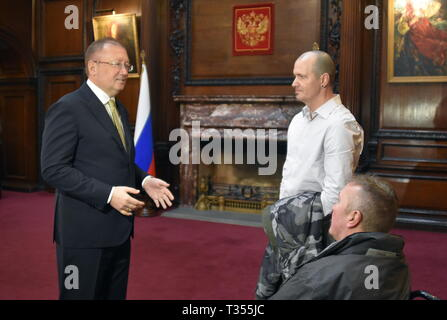 London, UK. 06th Apr, 2019.  Russian Ambassador to the UK Alexander Yakovenko, UK citizen Charles Rowley and his brother Matthew Rowley (L-R) during a tour around the Russian Embassy in London. Charles Rowley and his partner Dawn Sturgess were hospitalised on June 30, 2018, in Amesbury; Ms Sturgess died on July 8. The couple was reportedly exposed to the Novichok poison, the same nerve agent that was used to poison former Russian military intelligence officer Sergei Skripal and his daughter Yulia in Salisbury months before. Ilya Dmitryachev/TASS Credit: ITAR-TASS News Agency/Alamy Live News - Stock Photo