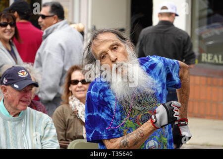 Pacific Grove, California, USA   6th April, 2019  Scenes from the traditional annual 'The Good ol Days' Festival on the main street of Pacific Grove - Lighthouse. Good ol Boy dances to The Rod band - Stock Photo