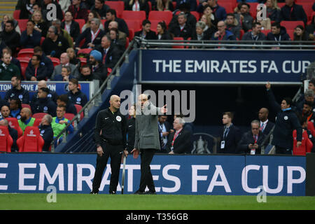 London, UK. 06th Apr, 2019. Pep Guardiola, the manager of Manchester city argues with the 4th official. The Emirates FA Cup, semi-final match, Manchester City v Brighton & Hove Albion at Wembley Stadium in London on Saturday 6th April 2019.  this image may only be used for Editorial purposes. Editorial use only, license required for commercial use. No use in betting, games or a single club/league/player publications . pic by Andrew Orchard/Andrew Orchard sports photography/Alamy Live news Credit: Andrew Orchard sports photography/Alamy Live News - Stock Photo