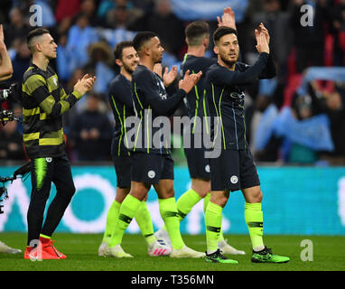 London, UK. 06th Apr, 2019. Manchester City's players celebrate victory after the FA Cup Semi-Final match between Manchester City and Brighton and Hove Albion at Wembley Stadium in London, Britain on April 6, 2019. Manchester City won 1-0.  FOR EDITORIAL USE ONLY. NOT FOR SALE FOR MARKETING OR ADVERTISING CAMPAIGNS. NO USE WITH UNAUTHORIZED AUDIO, VIDEO, DATA, FIXTURE LISTS, CLUB/LEAGUE LOGOS OR 'LIVE' SERVICES. ONLINE IN-MATCH USE LIMITED TO 45 IMAGES, NO VIDEO EMULATION. NO USE IN BETTING, GAMES OR SINGLE CLUB/LEAGUE/PLAYER PUBLICATIONS. (Xinhua) Credit: Xinhua/Alamy Live News - Stock Photo