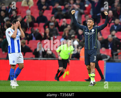 London, UK. 06th Apr, 2019. Manchester City's Danilo (R) celebrates victory after the FA Cup Semi-Final match between Manchester City and Brighton and Hove Albion at Wembley Stadium in London, Britain on April 6, 2019. Manchester City won 1-0.  FOR EDITORIAL USE ONLY. NOT FOR SALE FOR MARKETING OR ADVERTISING CAMPAIGNS. NO USE WITH UNAUTHORIZED AUDIO, VIDEO, DATA, FIXTURE LISTS, CLUB/LEAGUE LOGOS OR 'LIVE' SERVICES. ONLINE IN-MATCH USE LIMITED TO 45 IMAGES, NO VIDEO EMULATION. NO USE IN BETTING, GAMES OR SINGLE CLUB/LEAGUE/PLAYER PUBLICATIONS. (Xinhua) Credit: Xinhua/Alamy Live News - Stock Photo