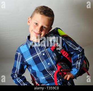 happy smiling boy carry a schoolbag preschool - Stock Photo