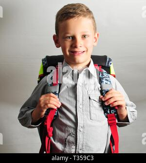 fresh smiling young boy with schoolbag - Stock Photo