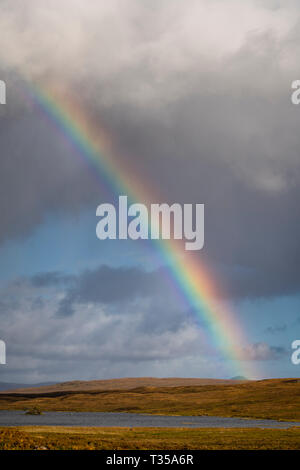 A vivid rainbow in northern Scotland. - Stock Photo
