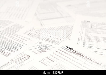 Blank income tax forms. American 1040 Individual Income Tax return form. Papers with empty and unfilles lines - Stock Photo