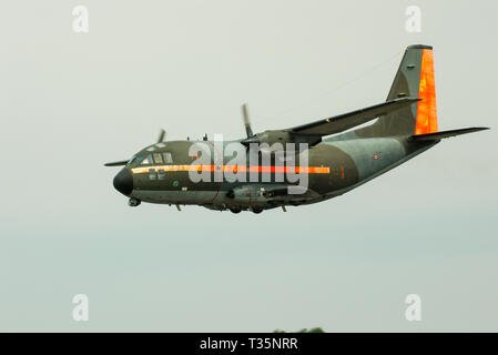 Italian Air Force Aeritalia G.222 MM62141 14-22 military transport plane. Rough heavy use exterior. Hard worn paint. Flying low. Dirty from use - Stock Photo