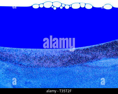 Blue background with bubbles at the top and a layer of sand at the bottom. Clean blue background with a lot of copy space. - Stock Photo
