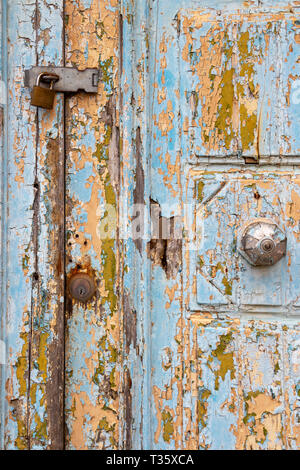 Detail of a beautiful old, light blue painted, weathered, locked door at Rabat Malta - Stock Photo