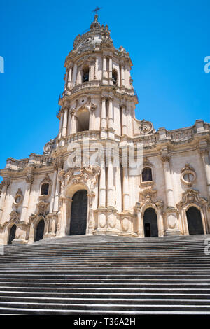 Front elevation and steps of Baroque style Cathedral of San Giorgio in Modica Alta ancient city, South East Sicily - Stock Photo