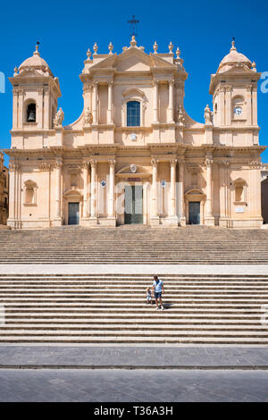 Front elevation and steps of Baroque Cathedral of Saint Nicholas - Basilica di San Nicolo in Noto city, Sicily, Italy - Stock Photo
