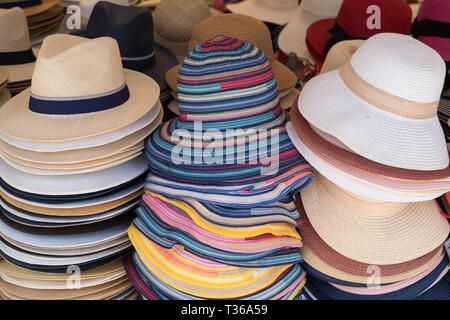 Panama and straw sun hats on display for sale on market stall at the old street market - Mercado -  in Ortigia, Syracuse, Sicily - Stock Photo