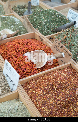 Dried goods, spices and condiments on display for sale on market stall at old street market - Mercado -  in Ortigia, Syracuse, Sicily - Stock Photo
