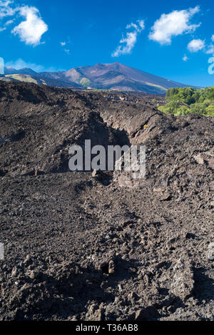 Lava field caused by volcanic eruption of Mount Etna an active stratovolcano on the east coast at Taormina, Sicily, Italy - Stock Photo