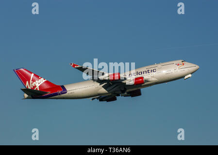Virgin Atlantic Boeing 747 Jumbo Jet jet airliner plane G-VBIG taking off from London Heathrow Airport, London, UK in blue sky with space for copy - Stock Photo