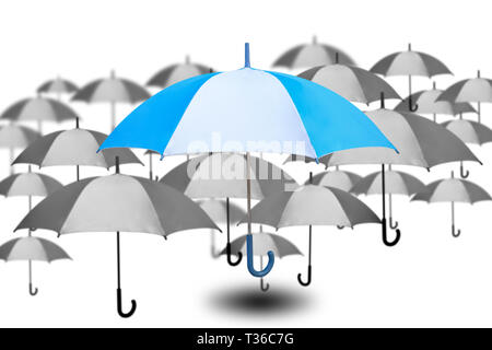Outstanding umbrella with small umbrella in monochrome color on white background, success and single choose from many choices, success working concept - Stock Photo
