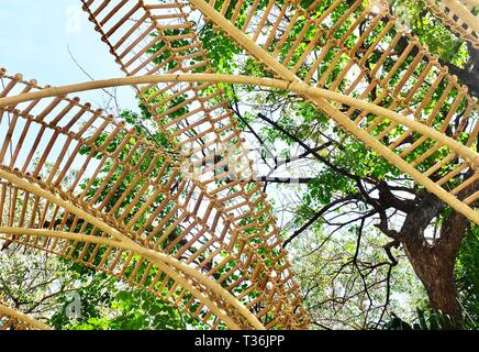 Bamboo Arch Over The Path or Walkway in A Garden Park for Walking Along.
