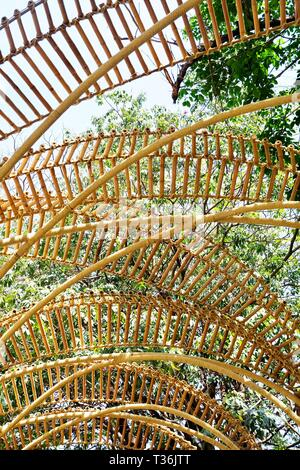 Bamboo Arch Over The Path or Walkway in A Garden Park for Walking Along. - Stock Photo