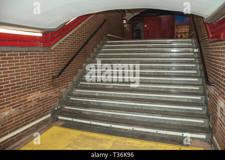 Stairway in a passage linking modern stations at the Madrid Subway. Capital of Spain with vibrant and intense cultural life. - Stock Photo