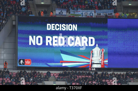 VAR checks for the possible red card incident in first half during the FA Cup Semi Final match between Brighton & Hove Albion and Manchester City at Wembley Stadium . 6 April 2019 Editorial use only. No merchandising. For Football images FA and Premier League restrictions apply inc. no internet/mobile usage without FAPL license - for details contact Football Dataco - Stock Photo