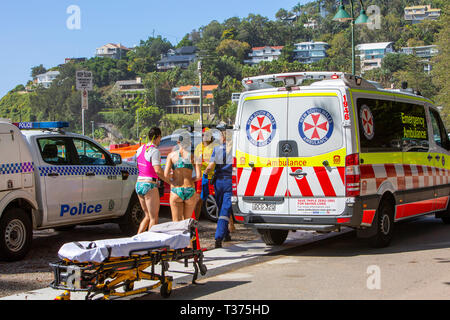 Sydney ambulance and paramedic with stretcher ready for a near drowning victim being carried off the beach,Sydney,Australia - Stock Photo