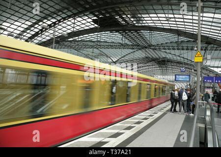 S-bahn train leaving Berlin Hauptbahnhof, Germany. - Stock Photo