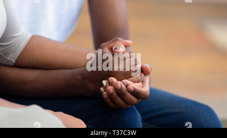 African american family couple holding hands, close up view - Stock Photo