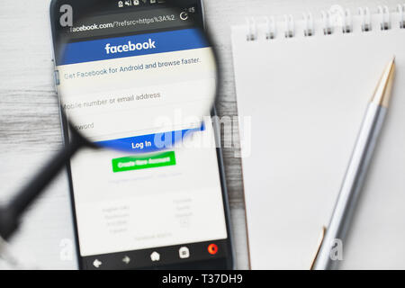 Los Angeles, California, USA - 3 April 2019: Facebook Social networking official website homepage under magnifying glass. Concept Facebook social medi - Stock Photo