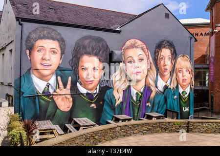 Mural featuring the main characters from the Channel 4 television series 'Derry Girls' on the wall of the Badger Pub, Derry, Londonderry, Northern Ire - Stock Photo