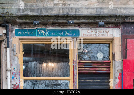 Ghost shop sign in Finnieston, Glasgow showing old cigarette advertising for Players No6 - Stock Photo