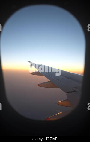 Wing of Airbus A320 passenger twin-engine jet airliners manufactured by Airbus traveling at high altitude over Gulf of Mexico - Stock Photo